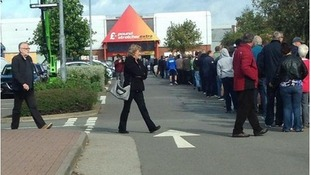 The queue outside the Ricoh Superstore as fans queue for tickets to CCFC's first home game in more than a year