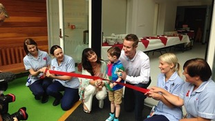 Seb Hollingsworth declares the play area open with dad Ivan