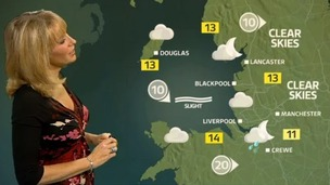 Emma in front of weather graphic