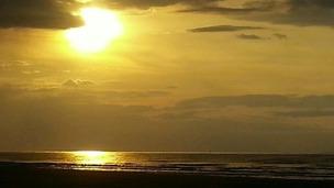 An August sunset on Brancaster beach in Norfolk.