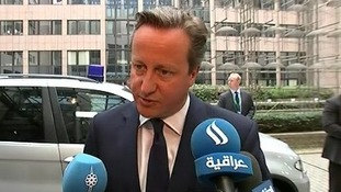 Prime Minister David Cameron speaking to reporters after arriving at the EU summit in Brussels