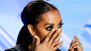Judge Melanie Brown wipes away a tear during one of the auditions
