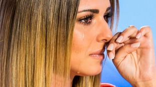 Cheryl Fernandez-Versini wipes away a tear during Amy Connelly's audition