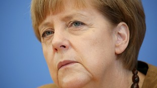 Germany's Chancellor, Angela Merkel, warned of new sanctions against Russia.