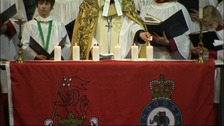 Reverend Canon Hilary Barber lights the last of the six candles to remember the six killed in Afghanistan 