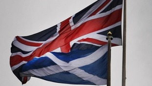 A Union flag and a Scottish flag.
