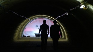 two men in dark tunnel