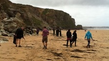 Volunteers picking up litter on Watergate Bay in Cornwall