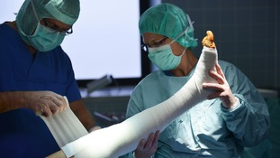 Patient's leg being bandaged during surgery