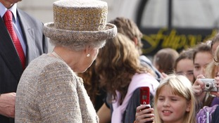 The Queen says she finds it strange to be greeted by a sea of mobile phones.