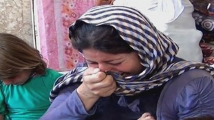 Sawsan cries as she tells Amnesty International her husband was abducted.
