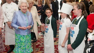 Queen Elizabeth II meets pupils from St Columba's Primary School, at a reception at Buckingham Palace, in central London.