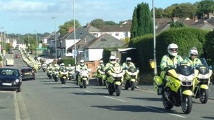 A convoy of police motorbikes on Caerleon Road, Newport on Sunday.