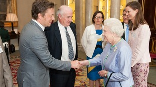Queen Elizabeth II meets chefs Jamie Oliver (left) and Rick Stein (2nd left) at a reception at Buckingham Palace, in central London.