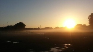 sunrise over misty field in Warrington