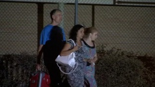 Brett King (left) and his wife Naghmeh (centre) leaving Soto del Real.