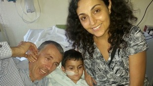 Ashya King with his parents at a hospital in Malaga.