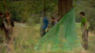 The group makes a tent to sleep in