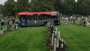bus sitting amongst grave stones