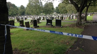 police tape at grave yard