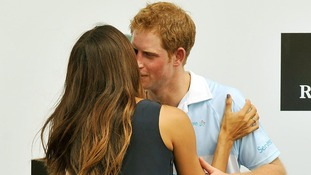 Prince Harry being kissed by Brazilian supermodel Fernanda Mutta after the Polo match where he captained Sentebale against St Regis