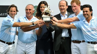 Prince Harry and his polo team, with Brazilian supermodel Fernanda Mutta receive the Sentabale Cup