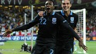 Danny Welbeck celebrates scoring England's third goal of the game with teammate Andy Carroll.