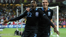 Danny Welbeck celebrates scoring England&#x27;s third goal of the game with teammate Andy Carroll.