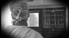 surgeon looking at heart monitor