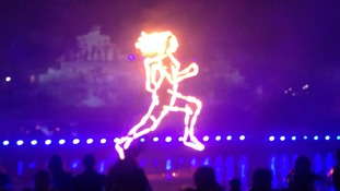 outline of woman runner in lights