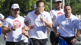 Prince Harry runs a mile for charity wearing a mask with Prince William's face on it
