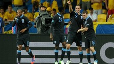 Andy Carroll celebrates scoring England's opener in Kiev.