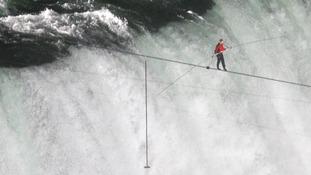 Stuntman conquers tightrope walk across Niagara Falls