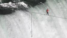 Tightrope walker Wallenda walks the high wire over the Horseshoe Falls in Niagara Falls