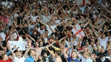 England fans celebrate their third goal scored by Danny Welbeck, in the stands