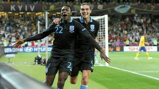 England's Danny Welbeck celebrates with Andy Carroll (right) after scoring the winning goal.