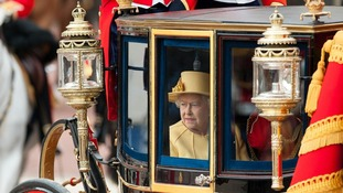 The Queen leaves Buckingham Palace to attend the Trooping the Colour parade.