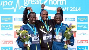 Mo Farah celebrates his first placed finish with second placed Mike Kigen (left) and third placed Stephen Kiprotich (right).