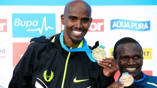 The Olympic medallist holds up his Great North Run medal.