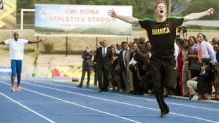 Prince Harry storms down the race track and leaves Usain Bolt trailing
