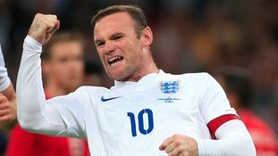 Wayne Rooney celebrates scoring for England.