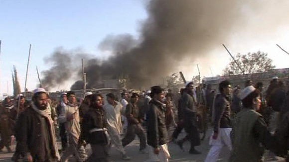 Protests in Afghanistan after reports that copies of the Koran were burned in an incinerator at Bagram airbase