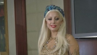 Lady Gaga smiles on her arrival at Dubai airport.