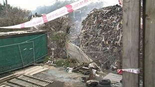 Fire crews have made 'significant progress' since tonnes of waste were removed from the site