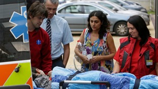 Ashya King, a 5-year-old British boy with a brain tumour, lies on a stretcher as he arrives with his parents at the Proton Therapy Center in Prague.