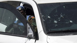 UN observers inspect damaged UN cars upon their return to Damascus, Syria