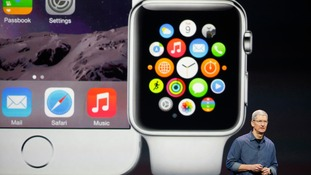 Apple CEO Tim Cook speaks during an Apple event announcing the iPhone 6 and the Apple Watch