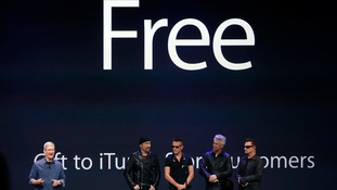 U2 with Apple CEO Tim Cook.