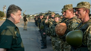 Ukrainian President Petro Poroshenko meets with Ukrainian servicemen during a visit to Mariupol earlier this week.