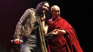Russell Brand and the Dalai Lama on stage at The Manchester Evening News Arena.